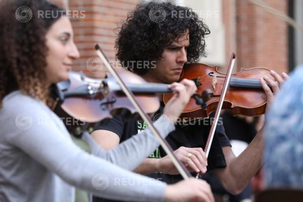 Musicians of Palestinian youth orchestra, who can't rehearse and play in their own land, play their instruments at the Amsterdam Museum Netherlands August 14, 2019. REUTERS/Eva Plevier