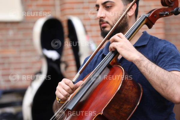 A musician of Palestinian youth orchestra, who can't rehearse and play in their own land, plays his instrument at the Amsterdam Museum Netherlands August 14, 2019. REUTERS/Eva Plevier