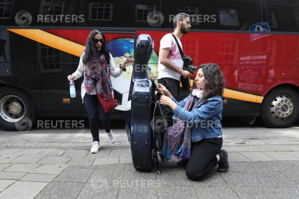 Musicians of Palestinian youth orchestra, who can't rehearse and play in their own land, arrive to the Amsterdam Museum Netherlands August 14, 2019. REUTERS/Eva Plevier