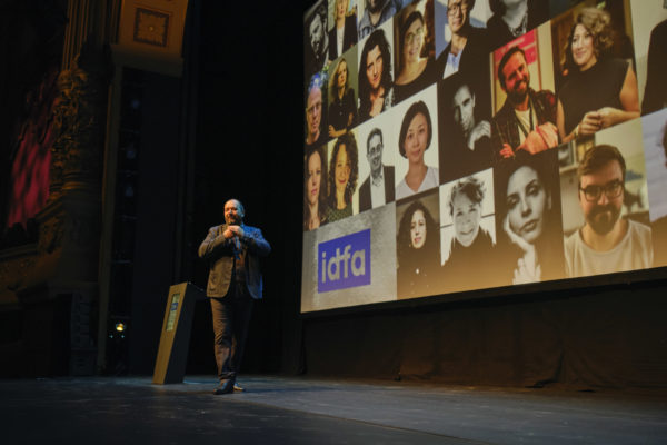 Nederland, Amsterdam, 20-11-2019 - Opening Night in Carré Theater. Orwa spreek het publiek toe. - Fotografie voor IDFA. - PHOTO AND COPYRIGHT ROGER CREMERS